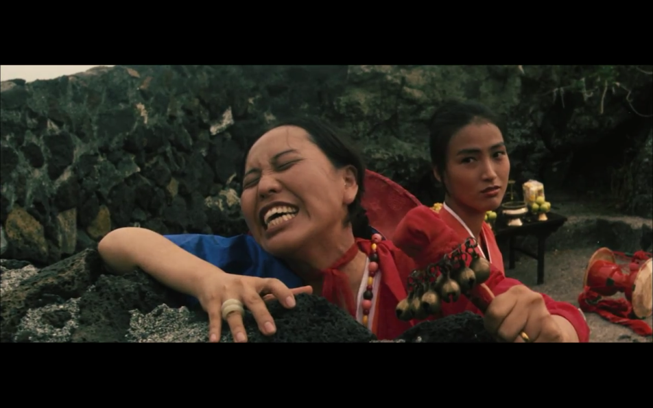 Shamans call for the return of Nam-seok's body.  In this film, the women are seen as having more power, but not using it wisely.
