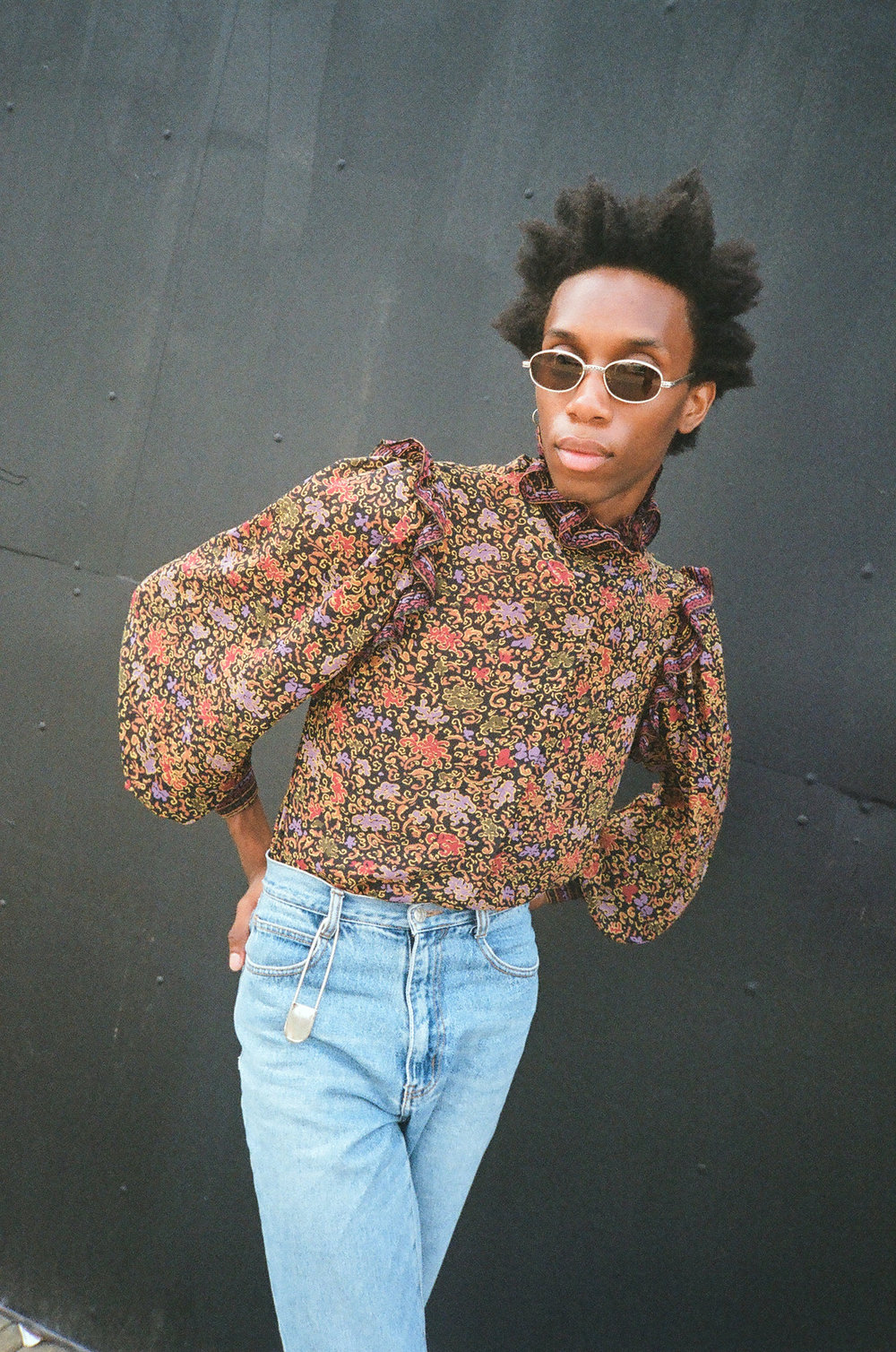 Parker wears a Vintage Oscar De La Renta Paisley Top, Vintage Denim, Vintage Sunglasses and  XL Pin , all from The Break.