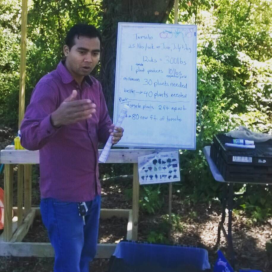 Siddi Rimal interprets during a training session with refugee gardeners.