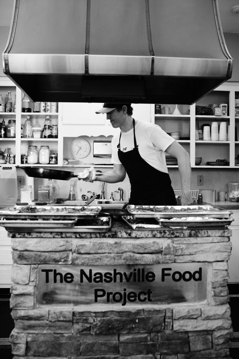 Chef Owen Clark of Rolf and Daughters working in The Nashville Food Project kitchens. Photo by Danielle Atkins.