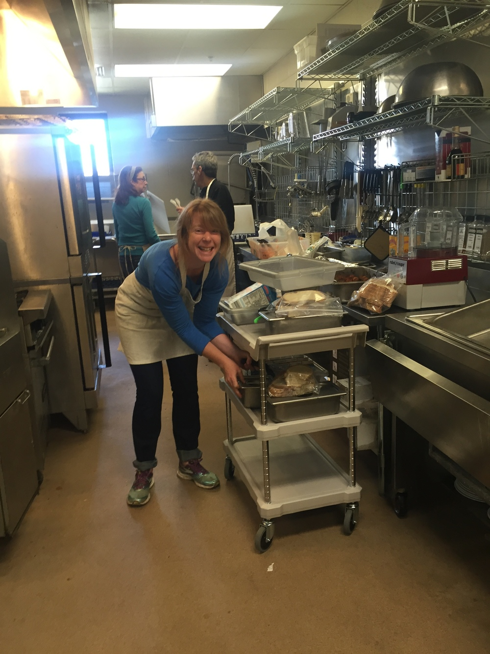 Here's Sarah loading up a cart to deliver meals to classrooms.