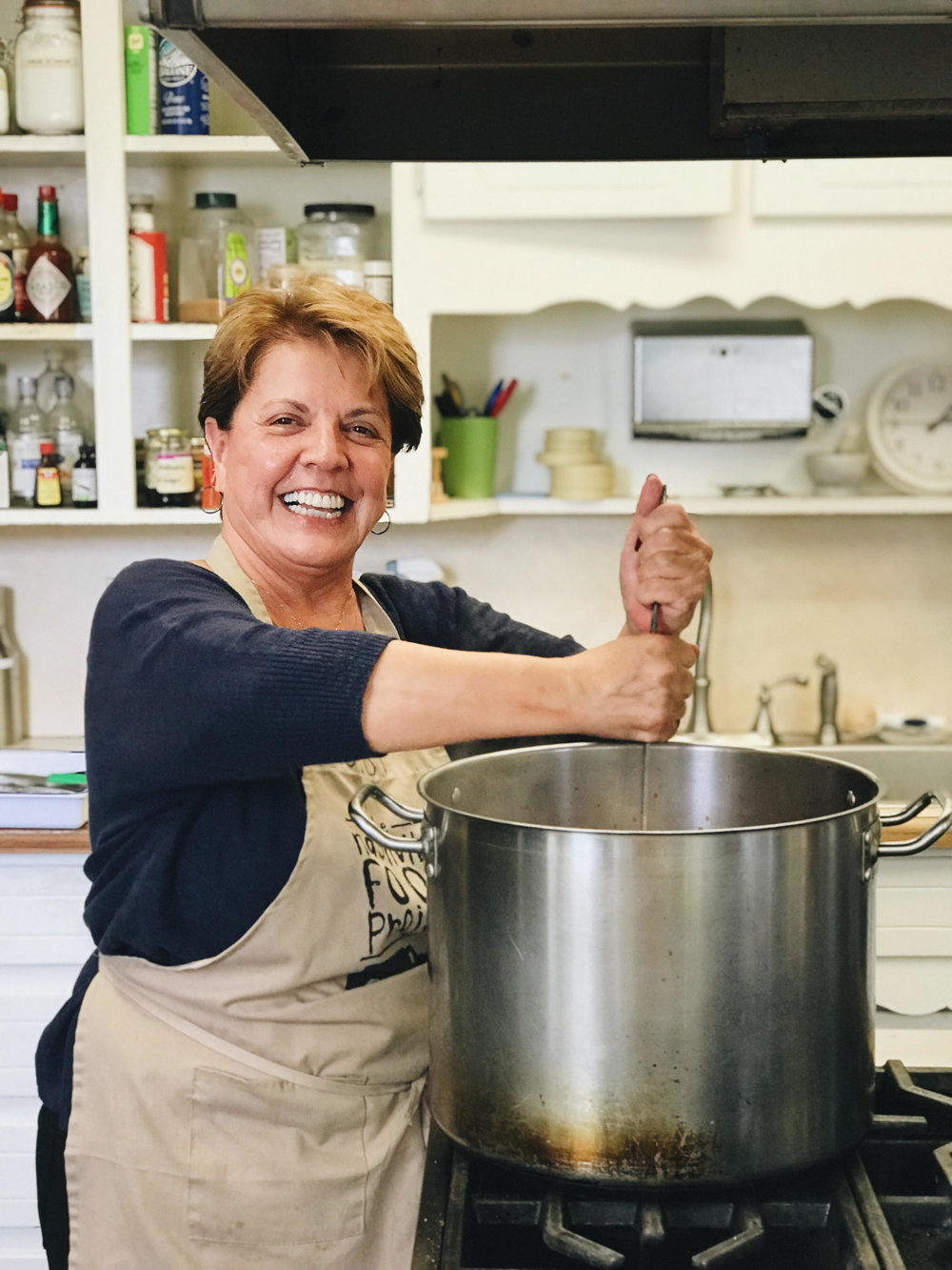 """November 2017: Judi Blondell Hardy """"Judi is an absolute treasure. Through her upbeat, spunky attitude and passion for good food, she brings JOY to everything she makes and everyone she encounters at TNFP (and also brings countless kitchen needs). We are so lucky to have her as a regular volunteer!"""""""
