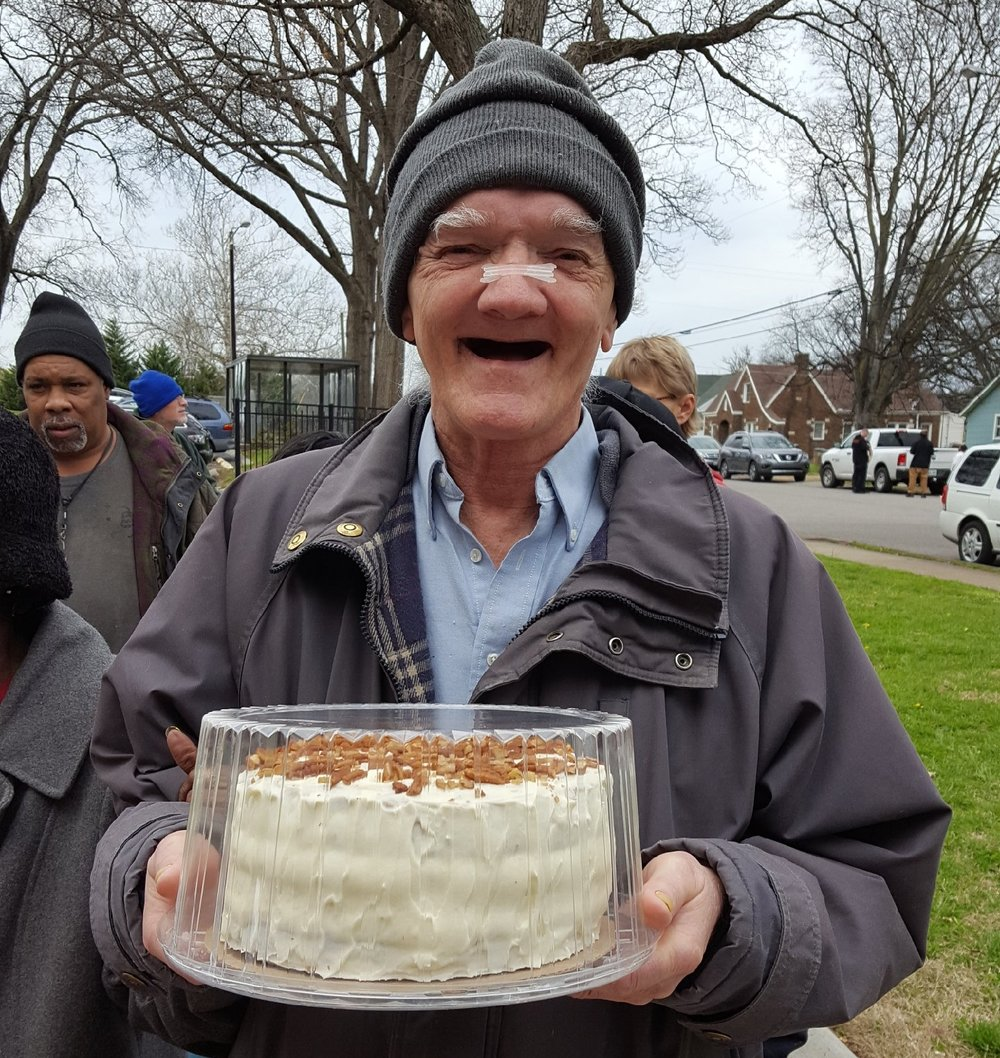 A hummingbird cake prepared by truck volunteer, Doug, for long-time Vine Hill Towers resident, Milton.