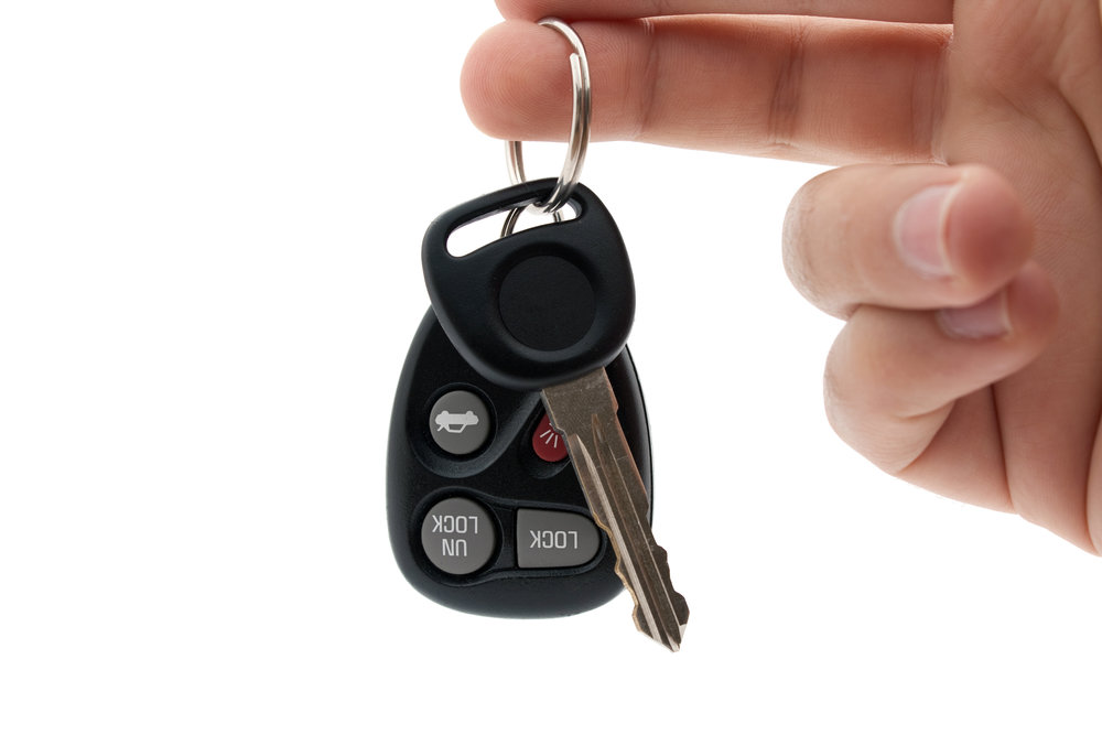 a-hand-holding-car-keys-and-a-remote-control-for-keyless-entry-isolated-over-white_HYJeBQvASo copy.jpg