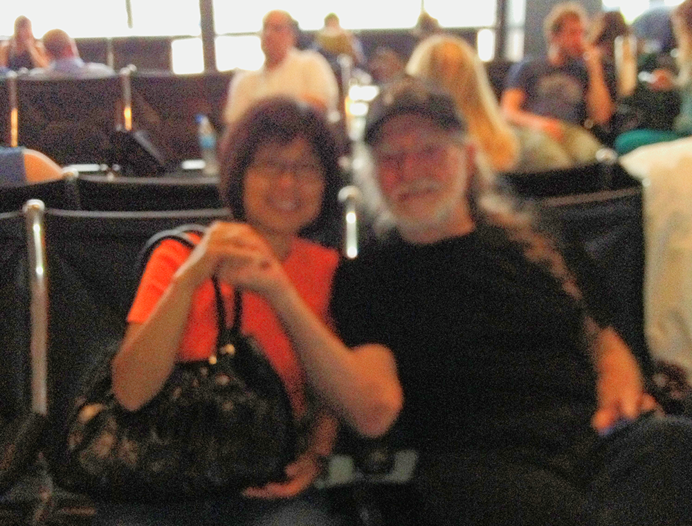 Willie Nelson with fan in Austin-Bergstrom International Airport by Henry Yip