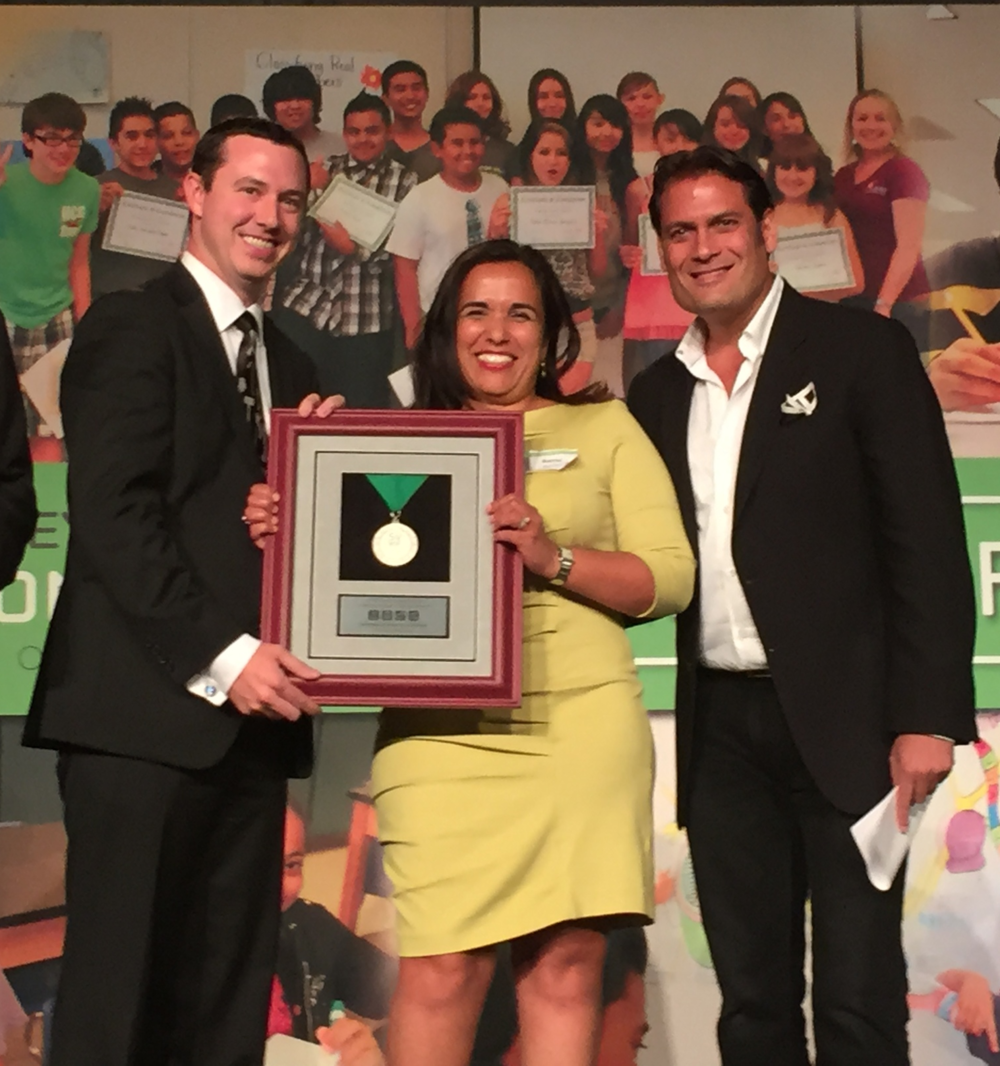 Renu Nandu (Executive Director of the Ravenswood Education Foundation) and Robert Pronovost (2015-2016 Director of Curriculum and Instruction in the Ravenswood City School District) accepting an award