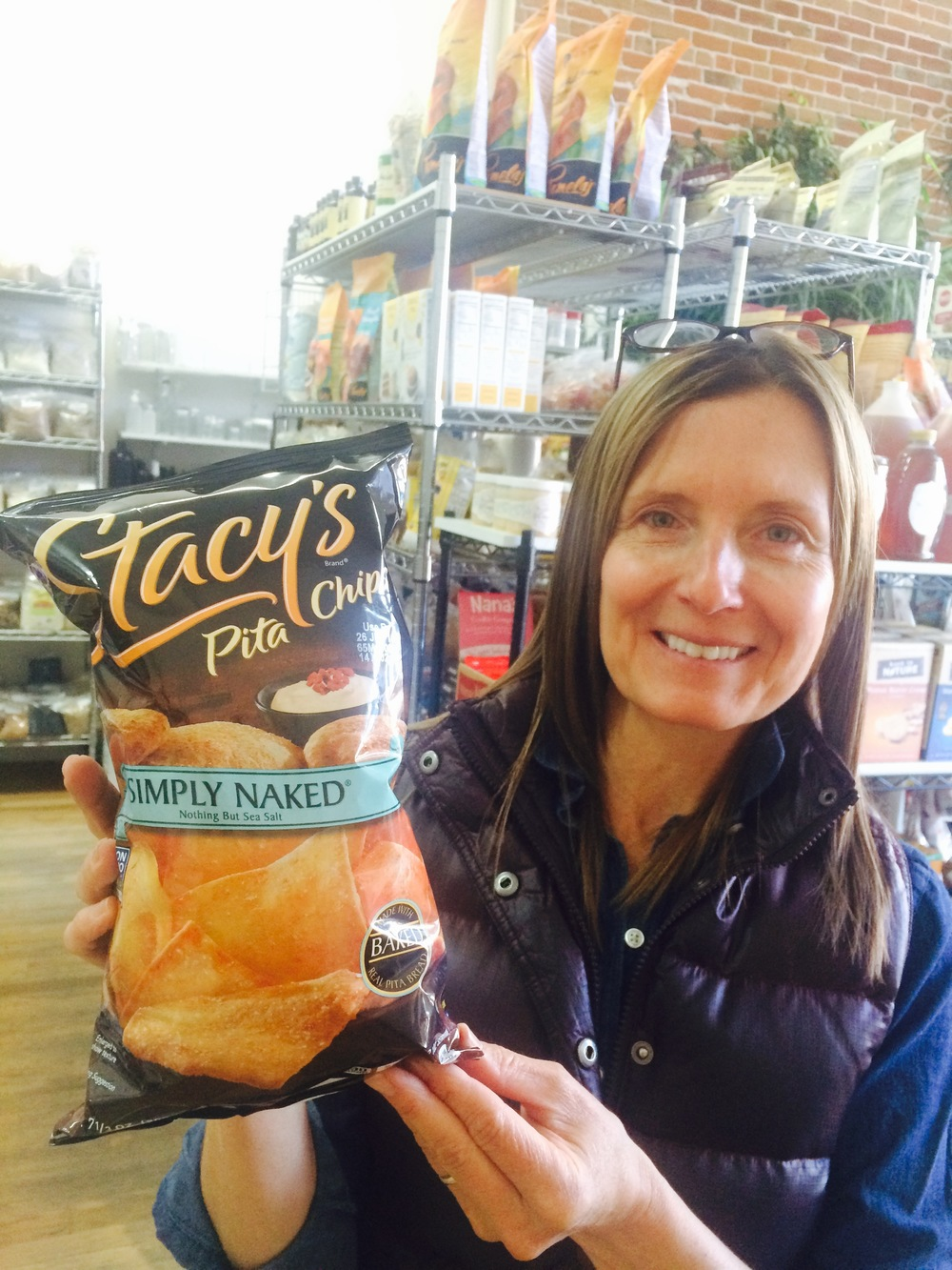 Gena Shepherd, our fearless owner, holding up our newest product, Stacy's Chips.
