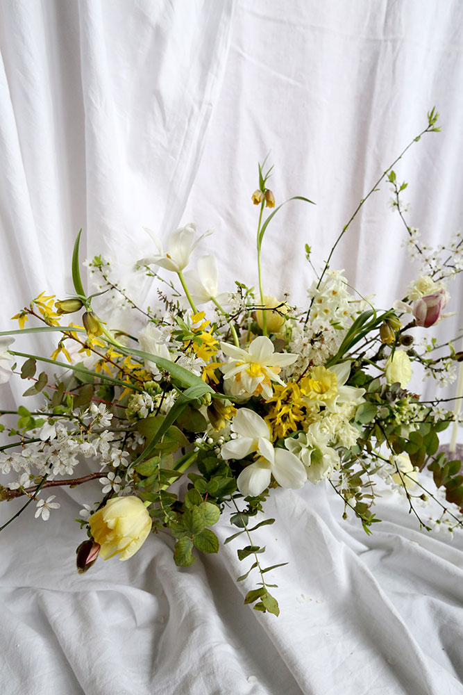 yellow spring wedding flowers with blossom daffodils and tulips