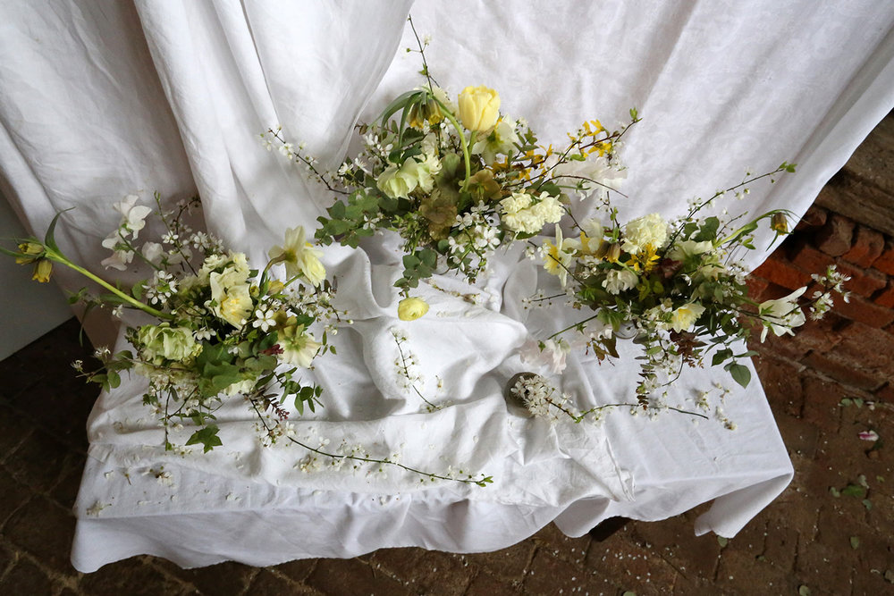 Unique spring yellow wedding table centrepieces with daffodils and tulips