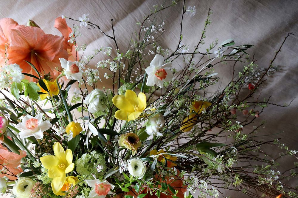 unusual large scale spring wedding vase arrangement with blossom and tulips