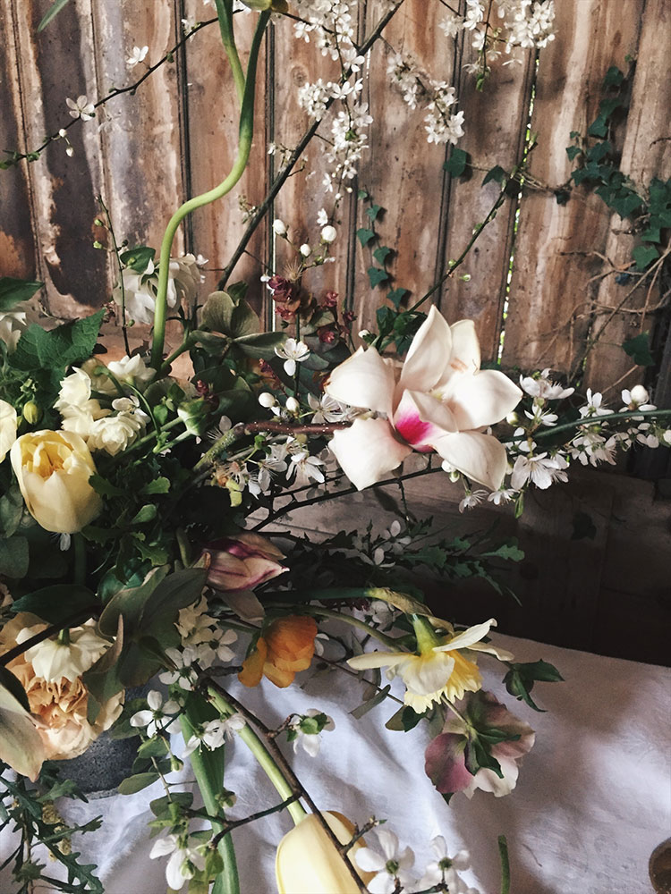 unique spring wedding table centre with magnolia and blossom