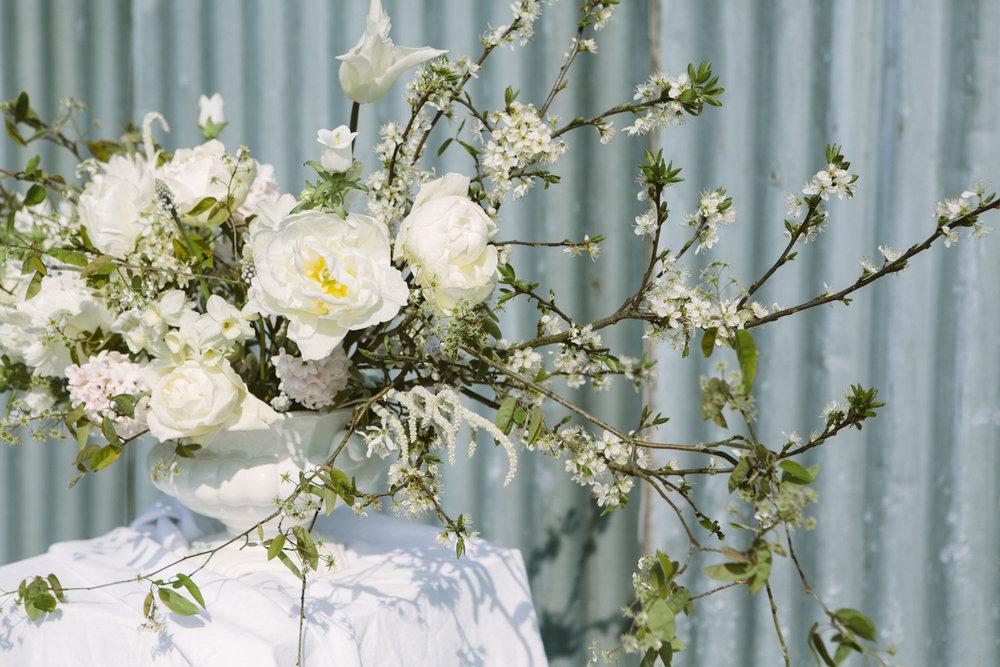 unique white spring wedding centrepiece vase arranagement