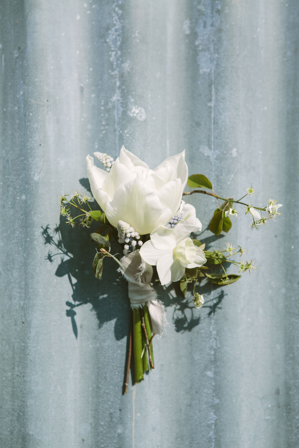 white spring wedding buttonholes with silk ribbon