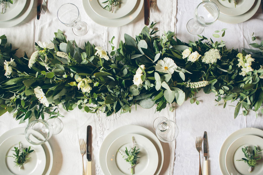 unique foliage table garland for a white summer wedding