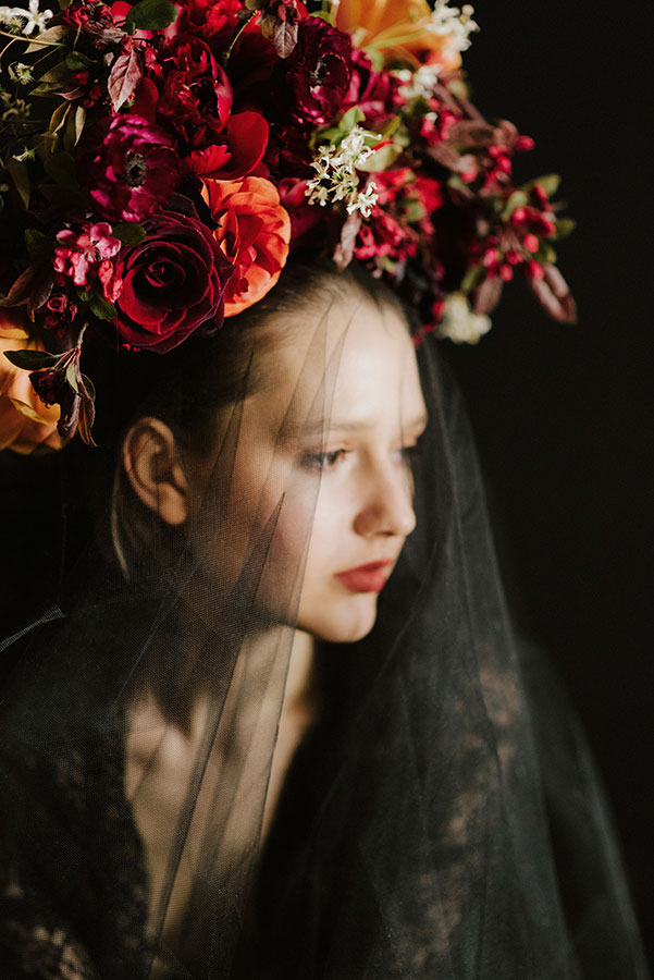 large floral crown with red and dark spring flowers
