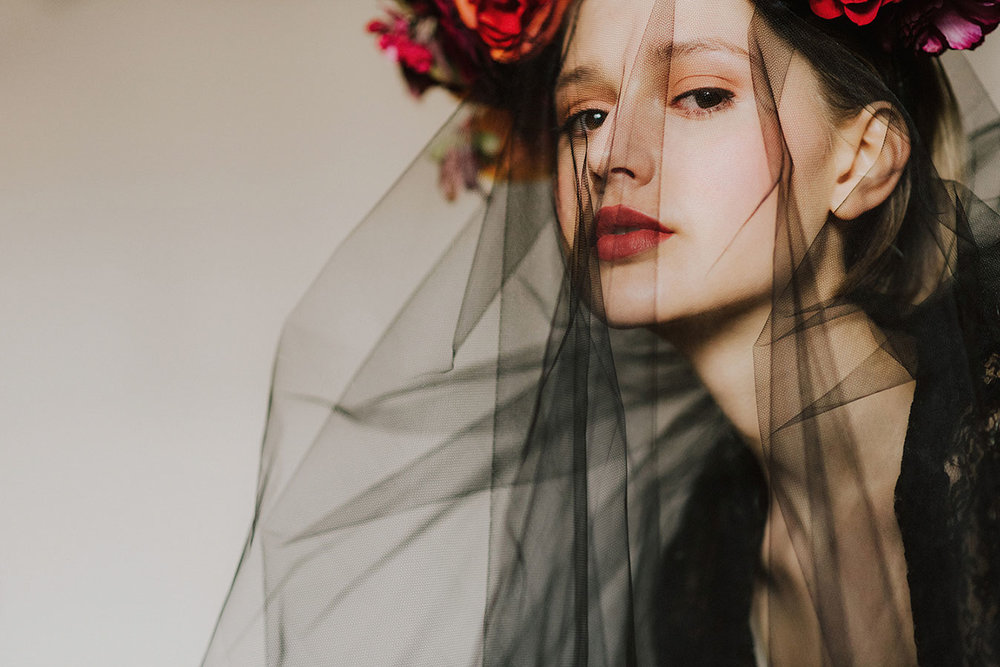 unique floral crown with black veil and red flowers
