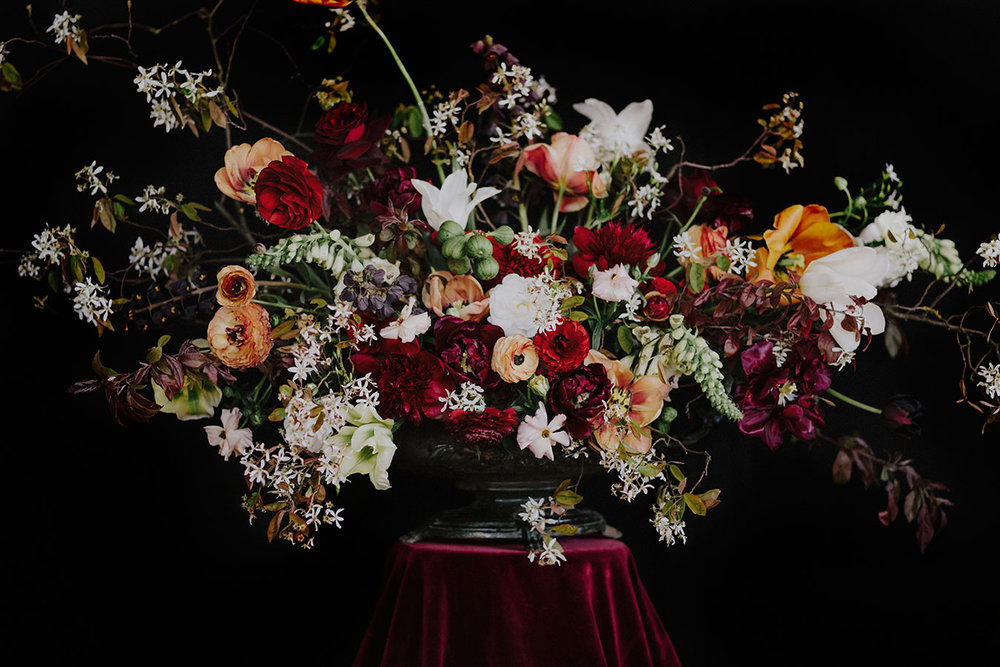 large wedding centrepiece with spring flowers in red and white