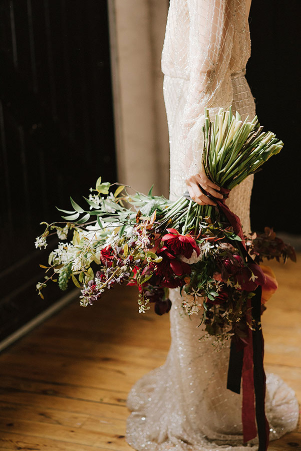 unique large dark and moody bridal bouquet with silk ribbon