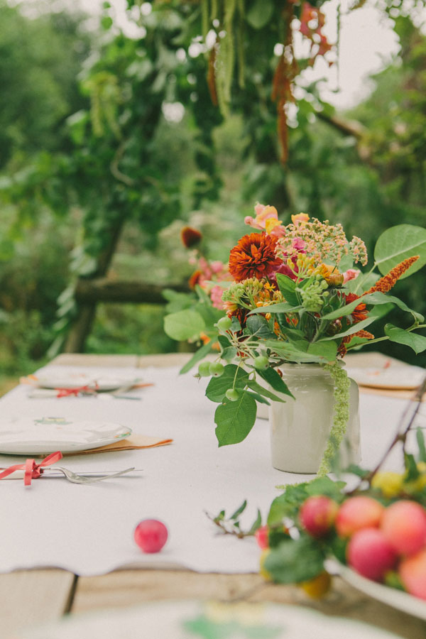 unique wedding feast and tablescape with bright flowers and fruits