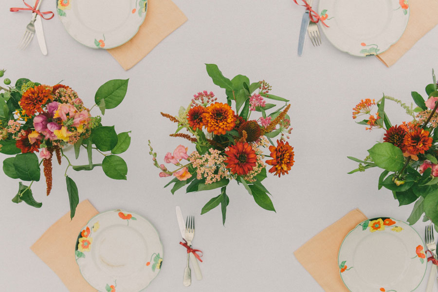 unusual summer tablescape and centerpieces with bright honegrown flowers.