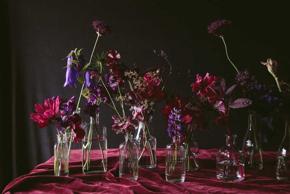 homegrown summer flowers in bottles