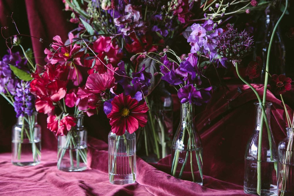 vintage antique bottles with summer red and pruple flowers