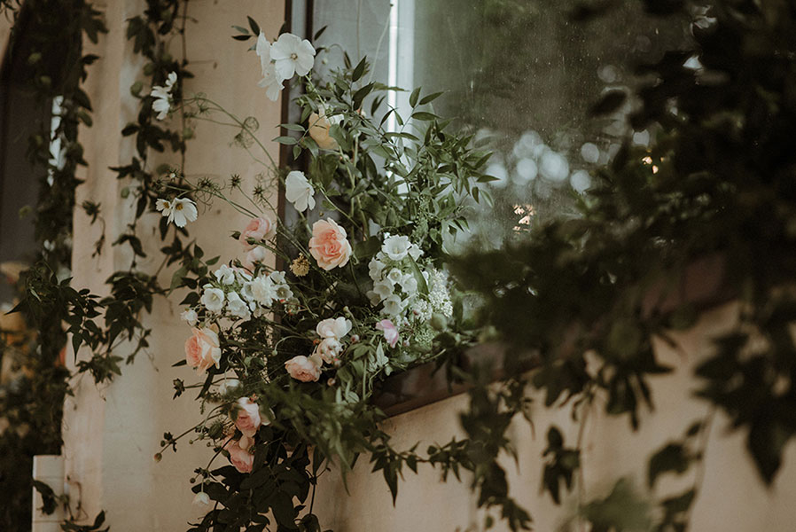 unique wedding floral installation with summer flowers