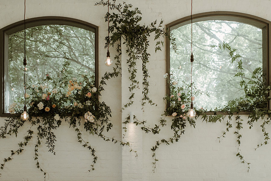 unique wedding floral installation with summer blooms and garden roses