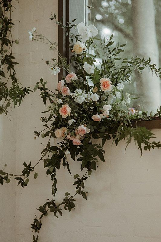 summer garden roses and vines creating a unique wedding installation piece