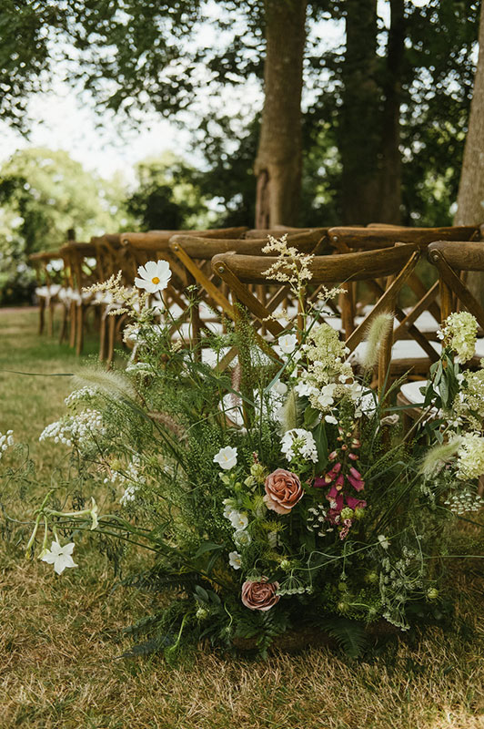 summer meadow style aisle for ceremony in Dorset