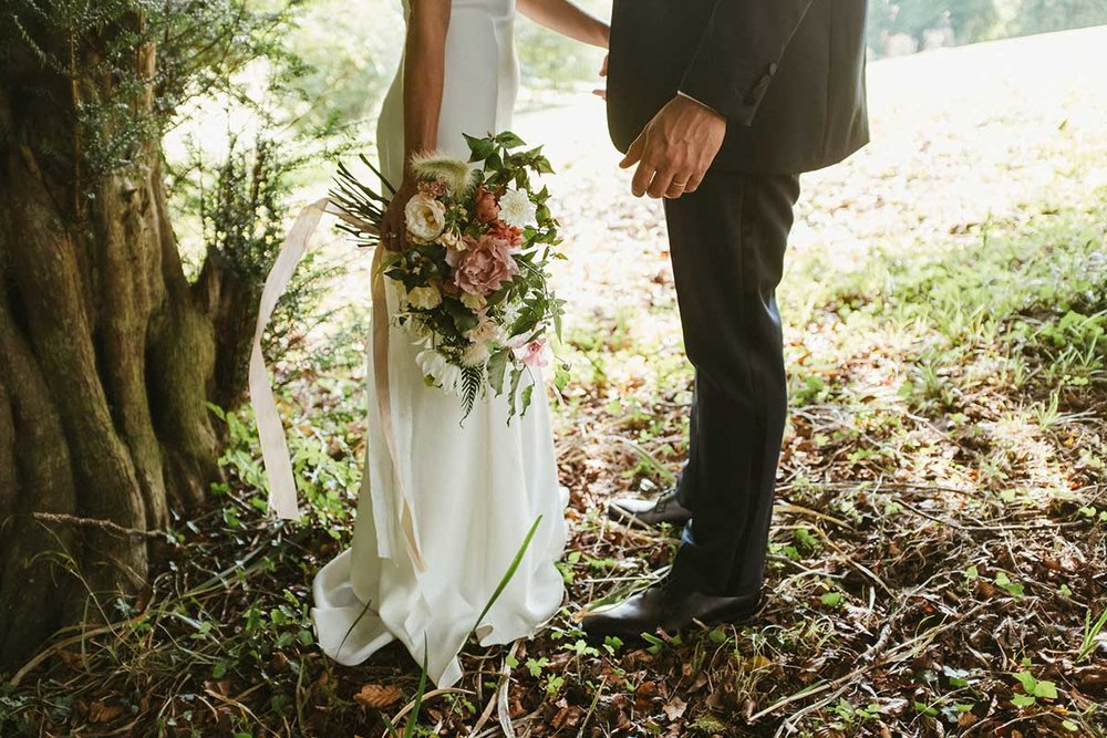 unique bridal bouquet with wild flowers and silk ribbon for a Dorset wedding