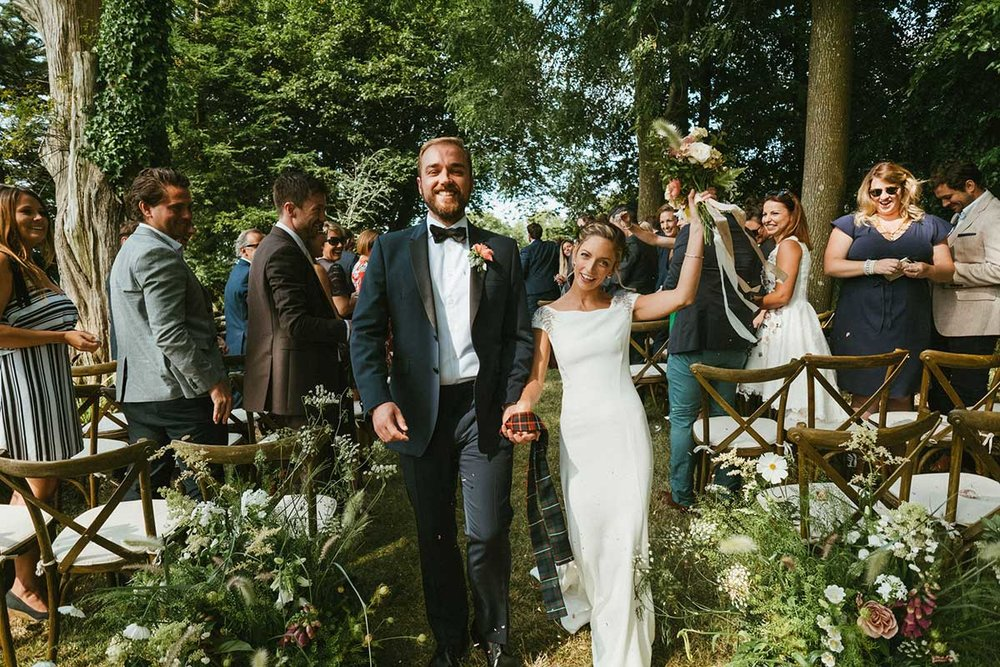 Unique summer wedding in a woodland in Dorset with wild flowers and garden roses