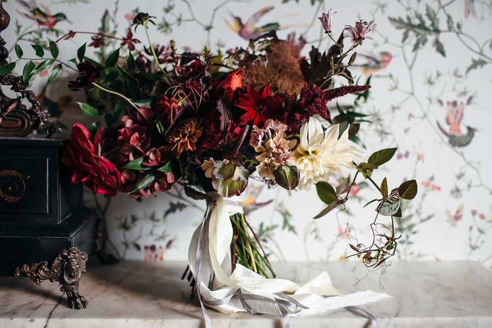 unique red and caramel flowers for a autumnal Devon wedding