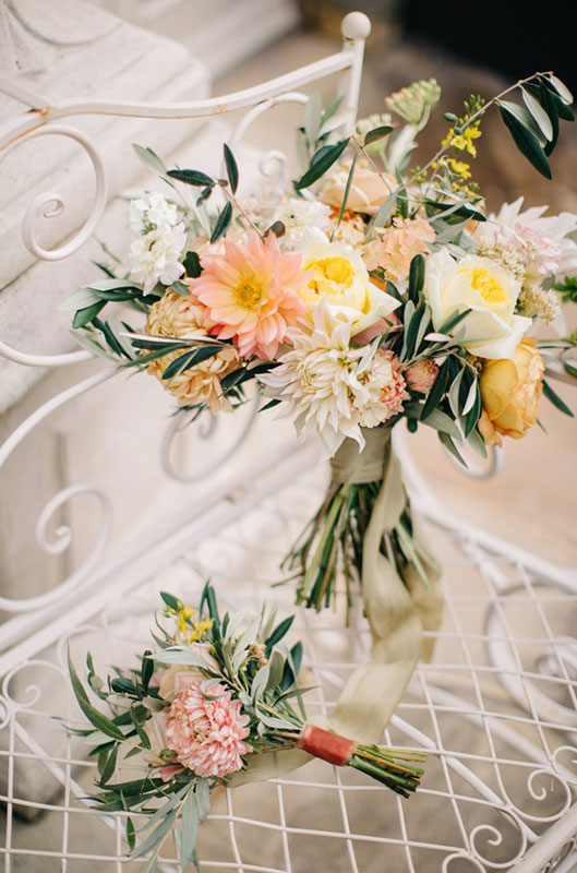 pastel coloured bridal bouquet with garden roses and summer dahalias