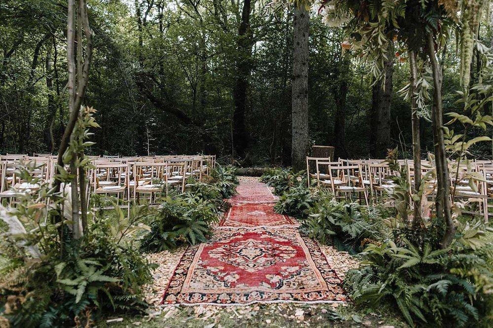 autumnal wedding with woodland ferns and foliage arch