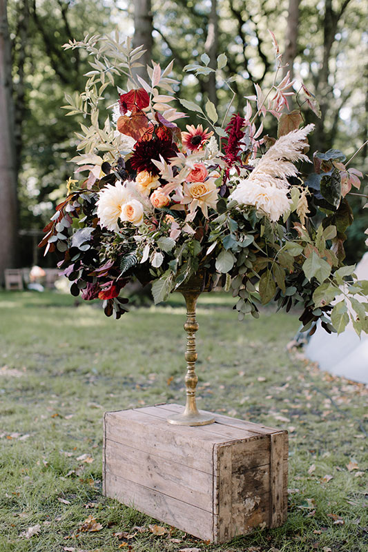 unique large urn arrangement for a woodland wedding
