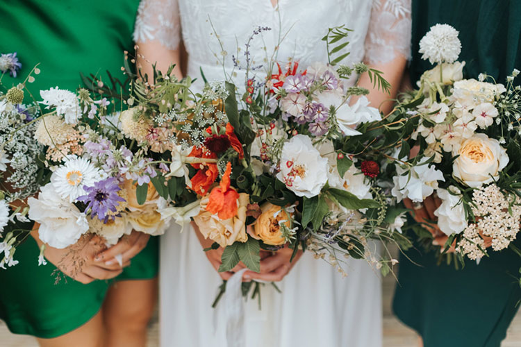 London wedding bridal bouquet and bridesmaids with summer flowers