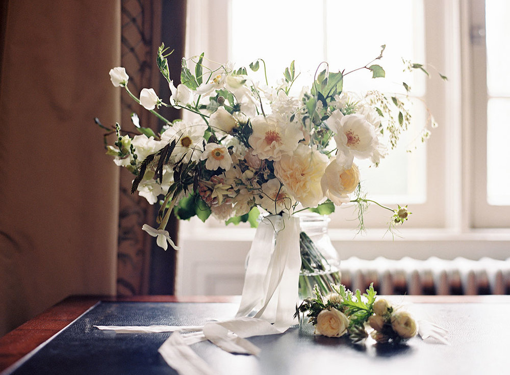 All white late summer wedding with homegrown flowers and roses