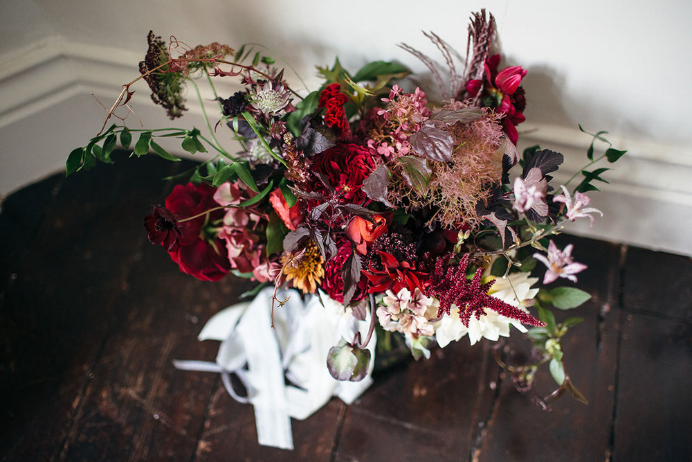 Vervain Unique Devon Wedding in Dark and Moody colours with autumnal blooms and silk ribbon