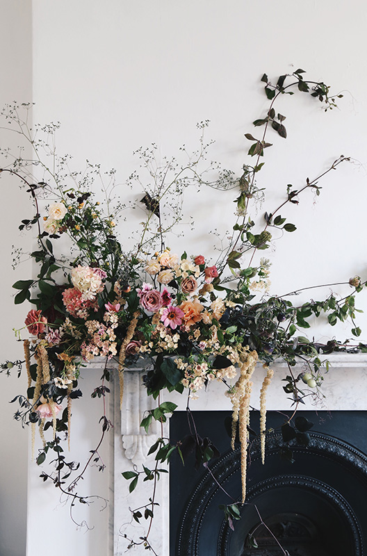 unique wedding mantle installation pieces with summer flowers and fruits