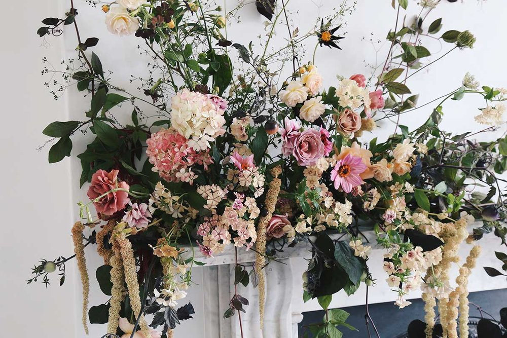 unique wedding mantle installation pieces with summer flowers, including phlox, tomatoes, garden roses and vines.