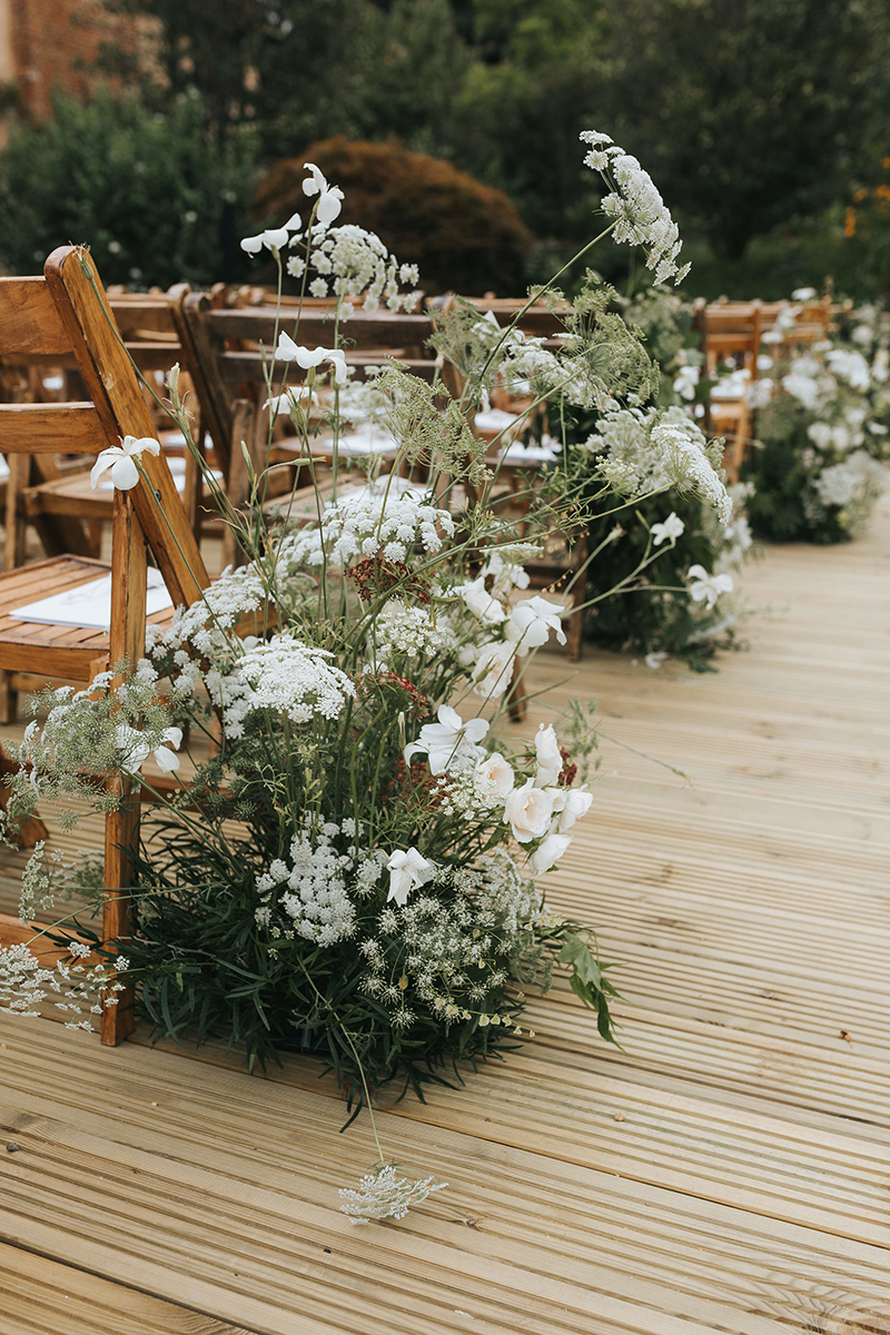 meadow style pew end by Vervain floral design studio for a summer wedding