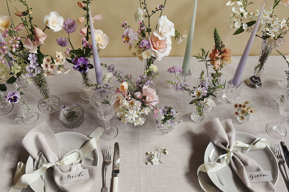 summer wedding flowers in pastel colours in cut glass vases table design