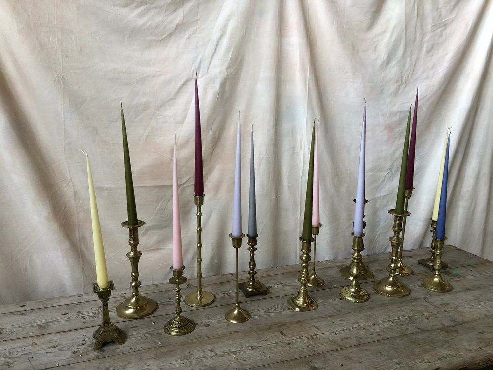 A selection of our antique brass candlesticks, with ester & erik tapered candles