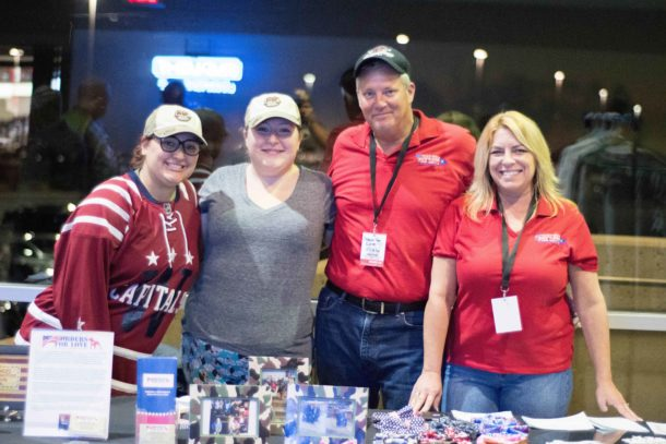 From left to right: Mallory Weimer, Grace Weimer, David Stouffer and Maria Stouffer.  Hanging at the booth during the Hershey Bears Hometown Heroes Night.  Photo courtsey of  Capitals Outsider Blog .