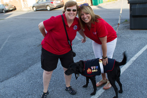 Maria Stouffer (R) OFL's Executive Director and Founder posed with Kate Van Auken (L) along with her service dog Sgt, Rey, a retired bomb sniffing dog who served two tours overseas, enjoyed the festivities in downtown Hershey. Van Auken is an active member of Dog T.A.G.S.. a local organization that trains service dogs for military with PTSD, and TBI.