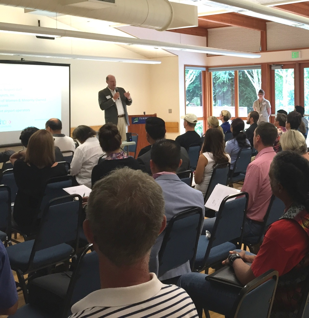 Port of Seattle Commissioner Tom Albro speaks to potential concessionaires at an outreach event in Tukwila on June 24.