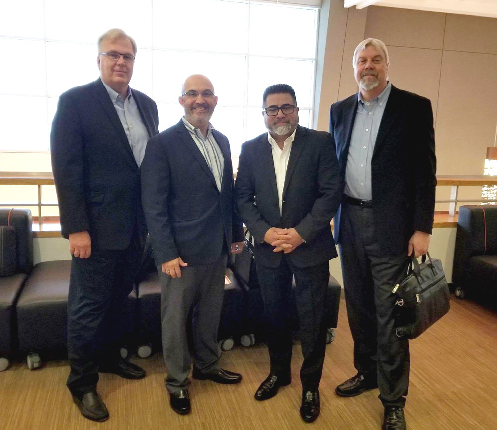 Dennis Brooks (Trio Group), Pedro Castro (Magellan Architects), Frank Lemos (LDC, Inc.) and Jeff Quint (Trio Group) at King County Executive's Small Business Awards