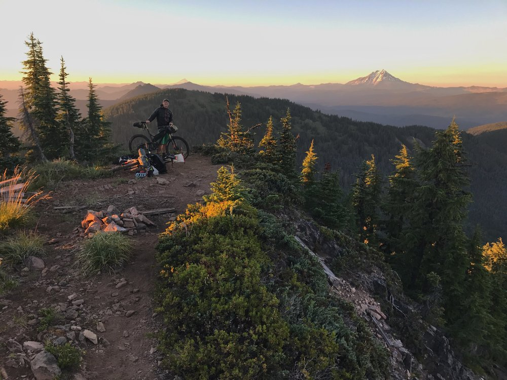 The reward for the push. Harry at the summit of Crescent, a massive highlight on the Oregon Timber Trail