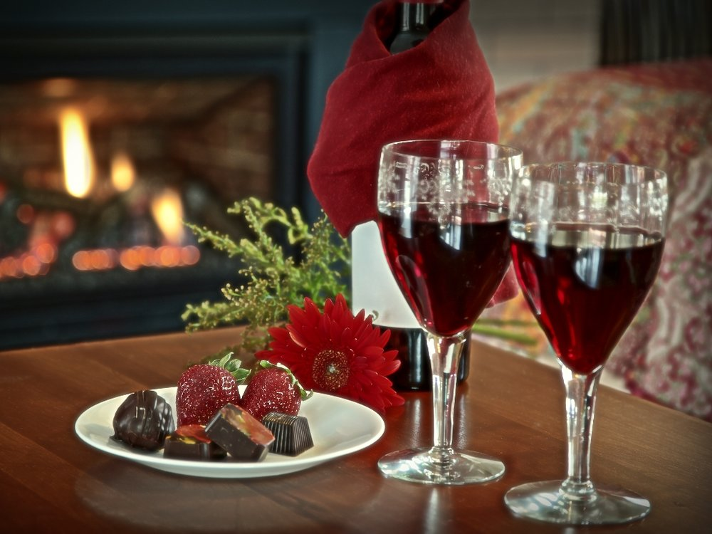 Wine and Chocolates in front of The Varsity Suite Fireplace.jpg
